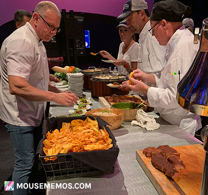 Chef Robert Irvine plating dishes at Party for the Senses 2018 Epcot Food and Wine Festival | Mouse Memos Disney Blog