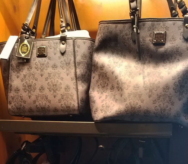 Dooney and Bourke Haunted Mansion Bags Memento Mori at Magic Kingdom | Mouse Memos Disney Blog