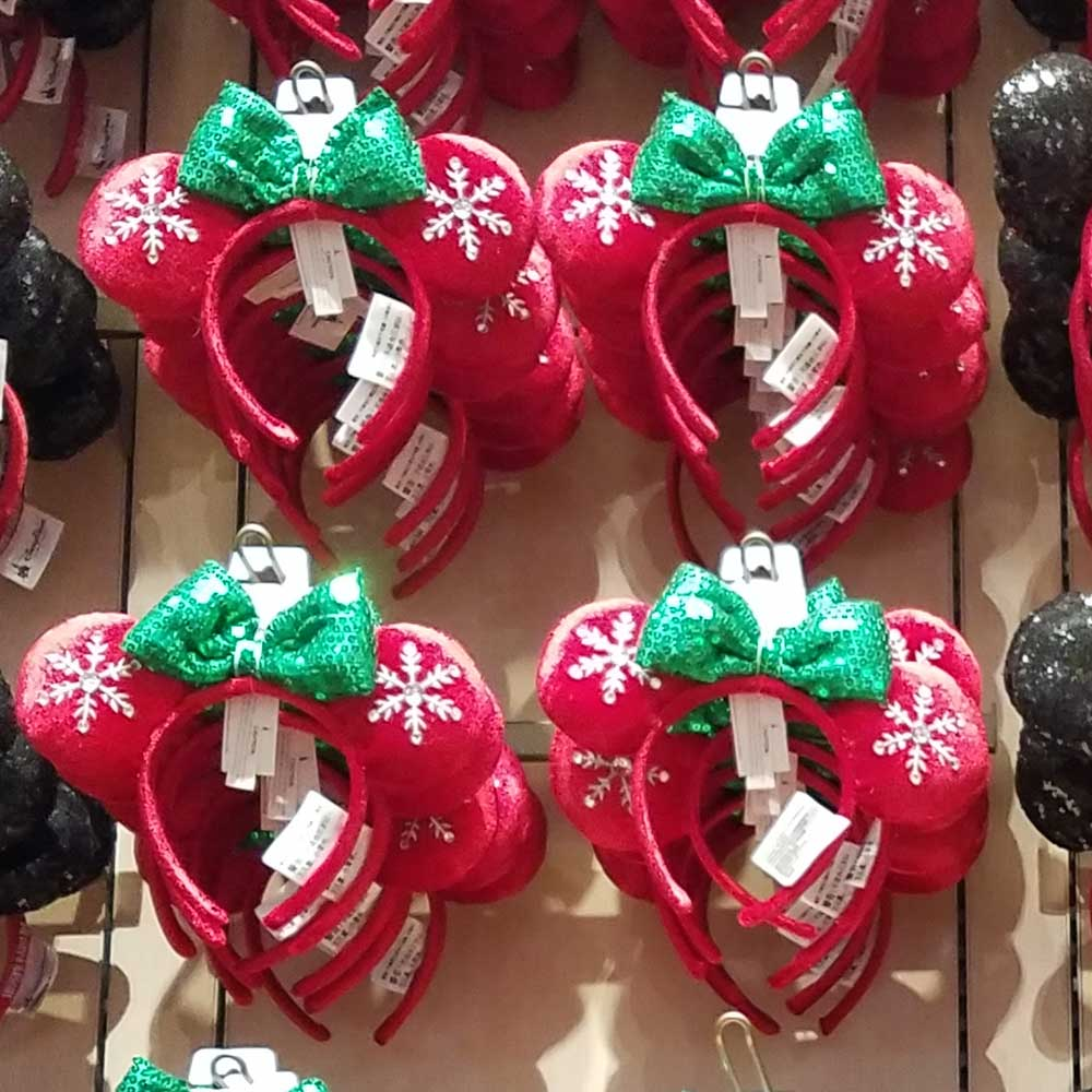 red snowflake mouse ears with green sparkle bow part of 2018 disney christmas apparel mouse